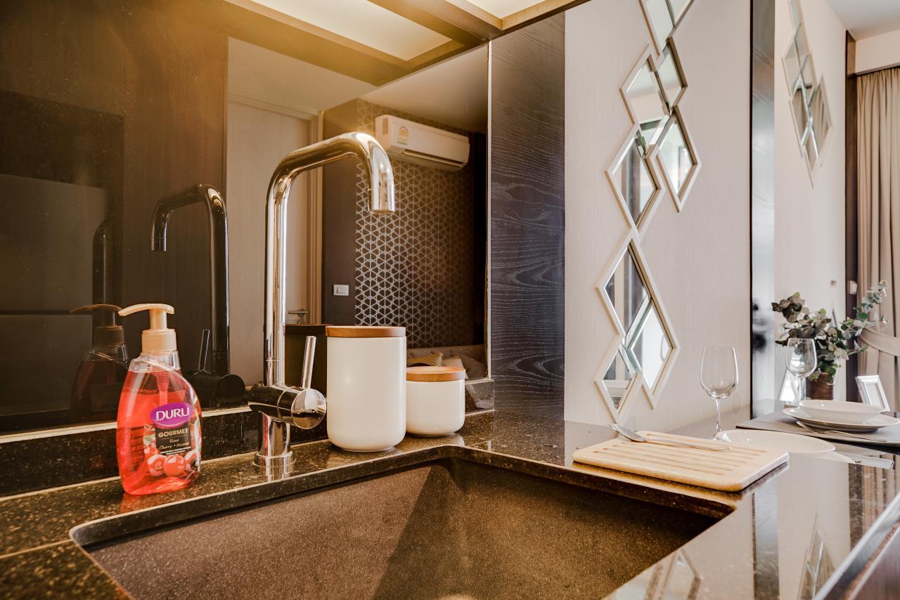 Hostmaker Bangkok Agency's Charming 1 Bed Apt w/ Balcony in Via 49 Condo 18
