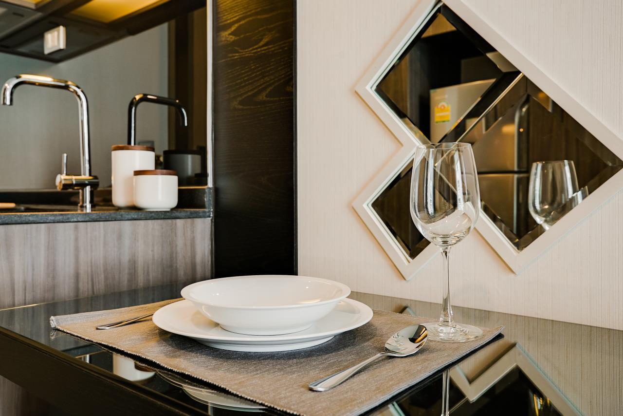Hostmaker Bangkok Agency's Charming 1 Bed Apt w/ Balcony in Via 49 Condo 14