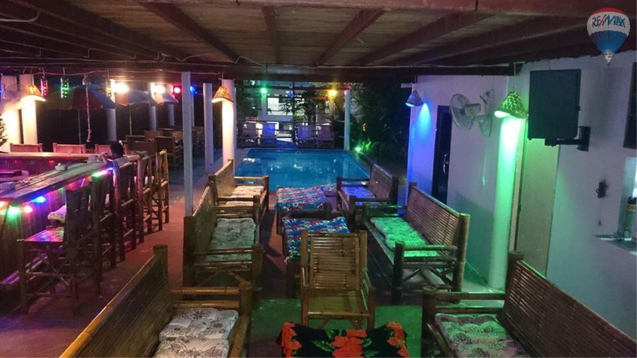 RE/MAX Top Properties Agency's Restaurant with swimming pool and sauna for sale at Naiharn 2