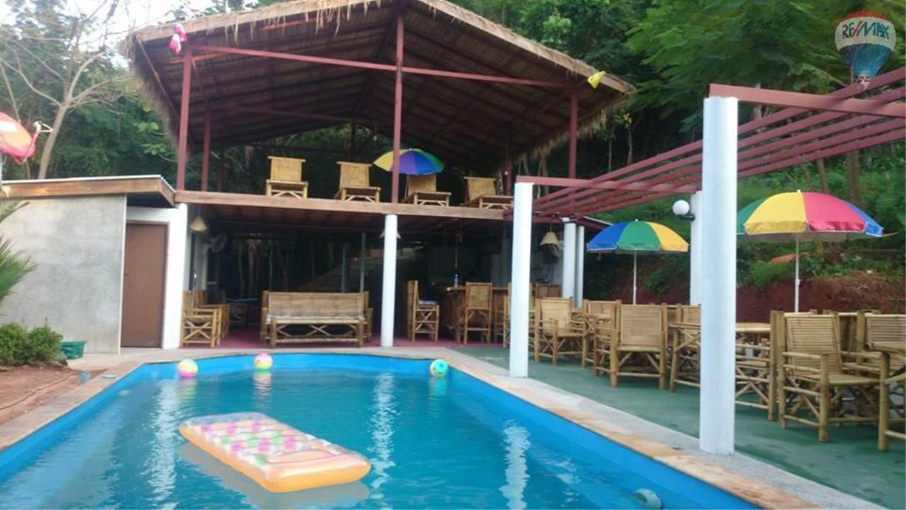 RE/MAX Top Properties Agency's Restaurant with swimming pool and sauna for sale at Naiharn 4