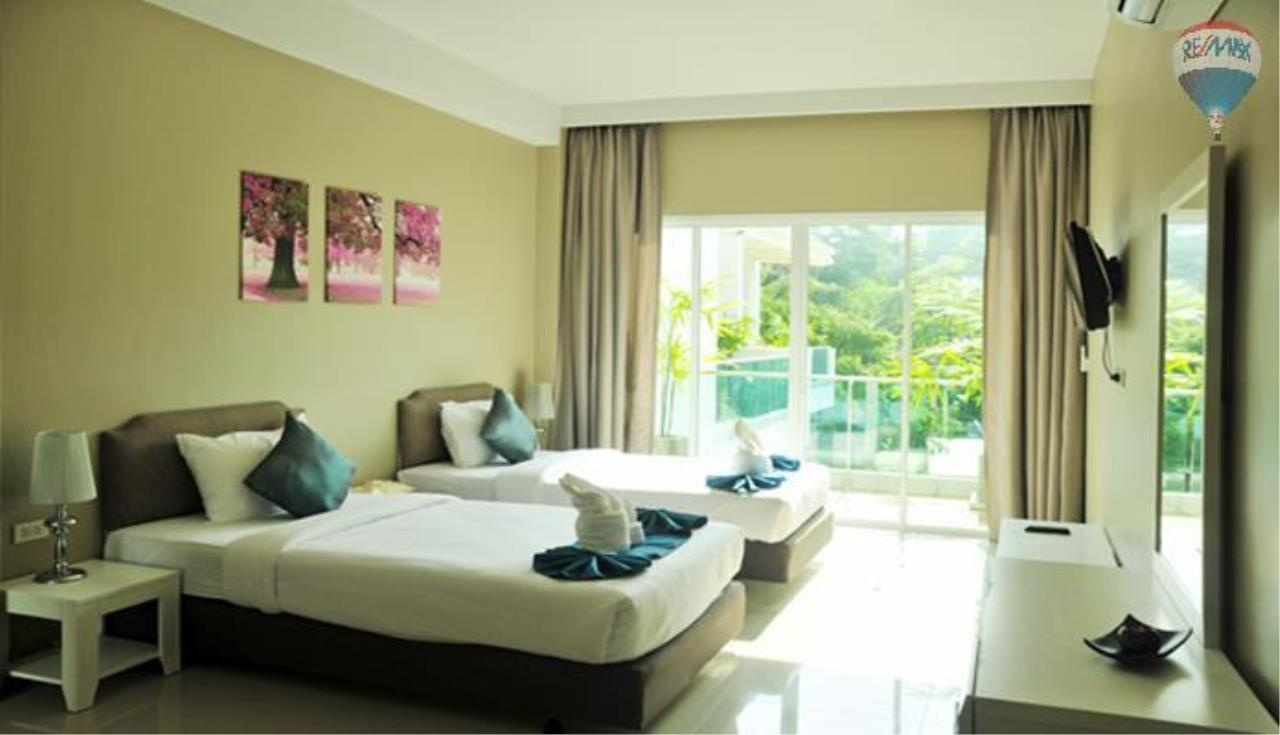 RE/MAX Top Properties Agency's 2 Bedroom penthouse with a sea view In Surin 6