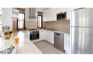 RE/MAX Top Properties Agency's PHUKET,LAGUNA BEACH,POOL VILLA 4 BEDROOS,FOR SALE 13