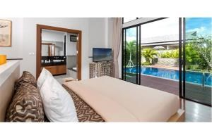 RE/MAX Top Properties Agency's PHUKET,LAGUNA BEACH,POOL VILLA 4 BEDROOS,FOR SALE 14