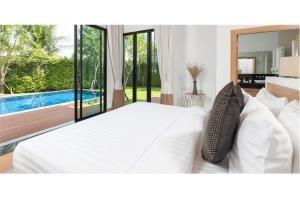 RE/MAX Top Properties Agency's PHUKET,LAGUNA BEACH,POOL VILLA 4 BEDROOS,FOR SALE 4