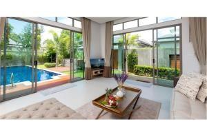 RE/MAX Top Properties Agency's PHUKET,LAGUNA BEACH,POOL VILLA 4 BEDROOS,FOR SALE 20