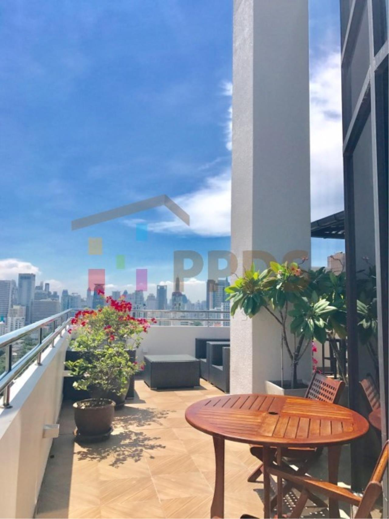 Propodyssey Agency's Duplex Penthouse with a large balcony and city is available for rent on Promphong Area. 4
