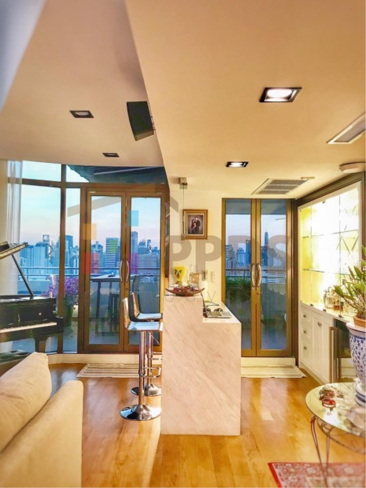 Propodyssey Agency's Duplex Penthouse with a large balcony and city is available for rent on Promphong Area. 7