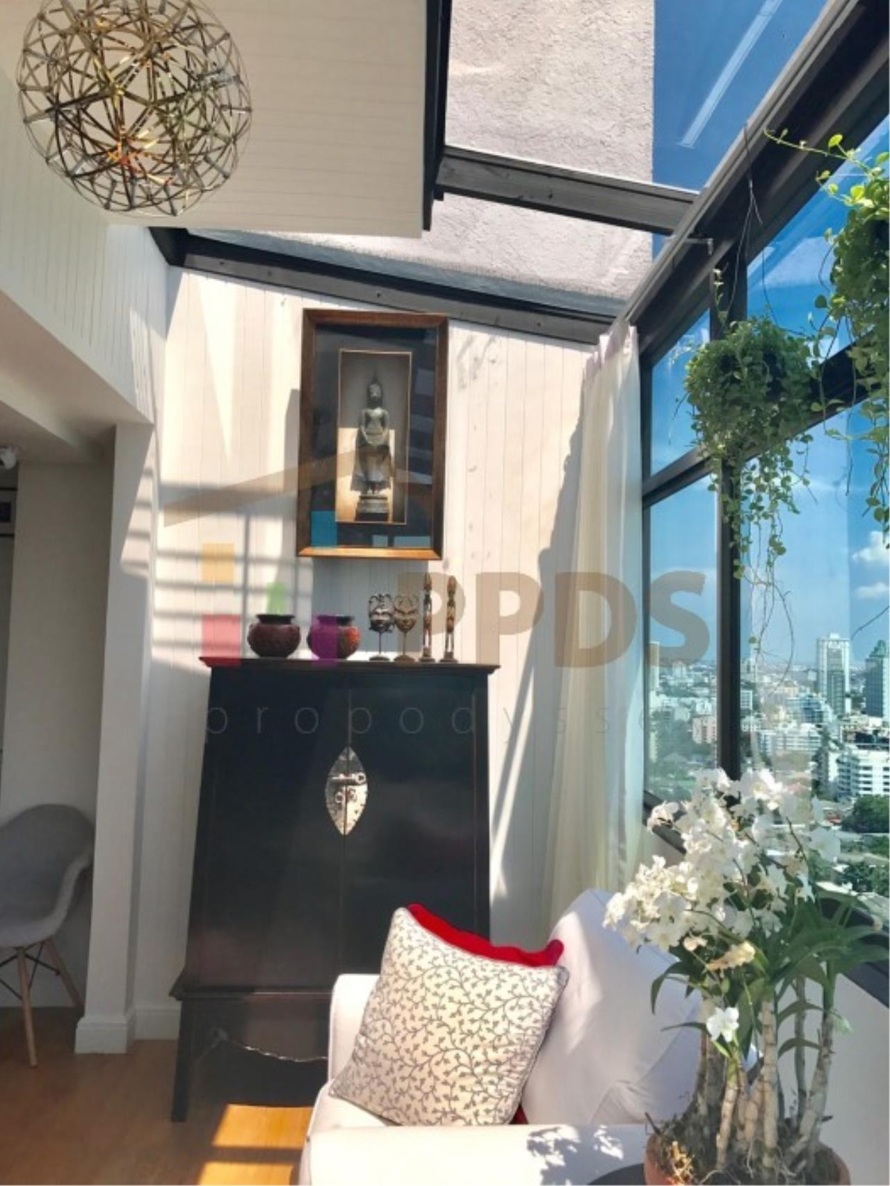 Propodyssey Agency's Duplex Penthouse with a large balcony and city is available for rent on Promphong Area. 19