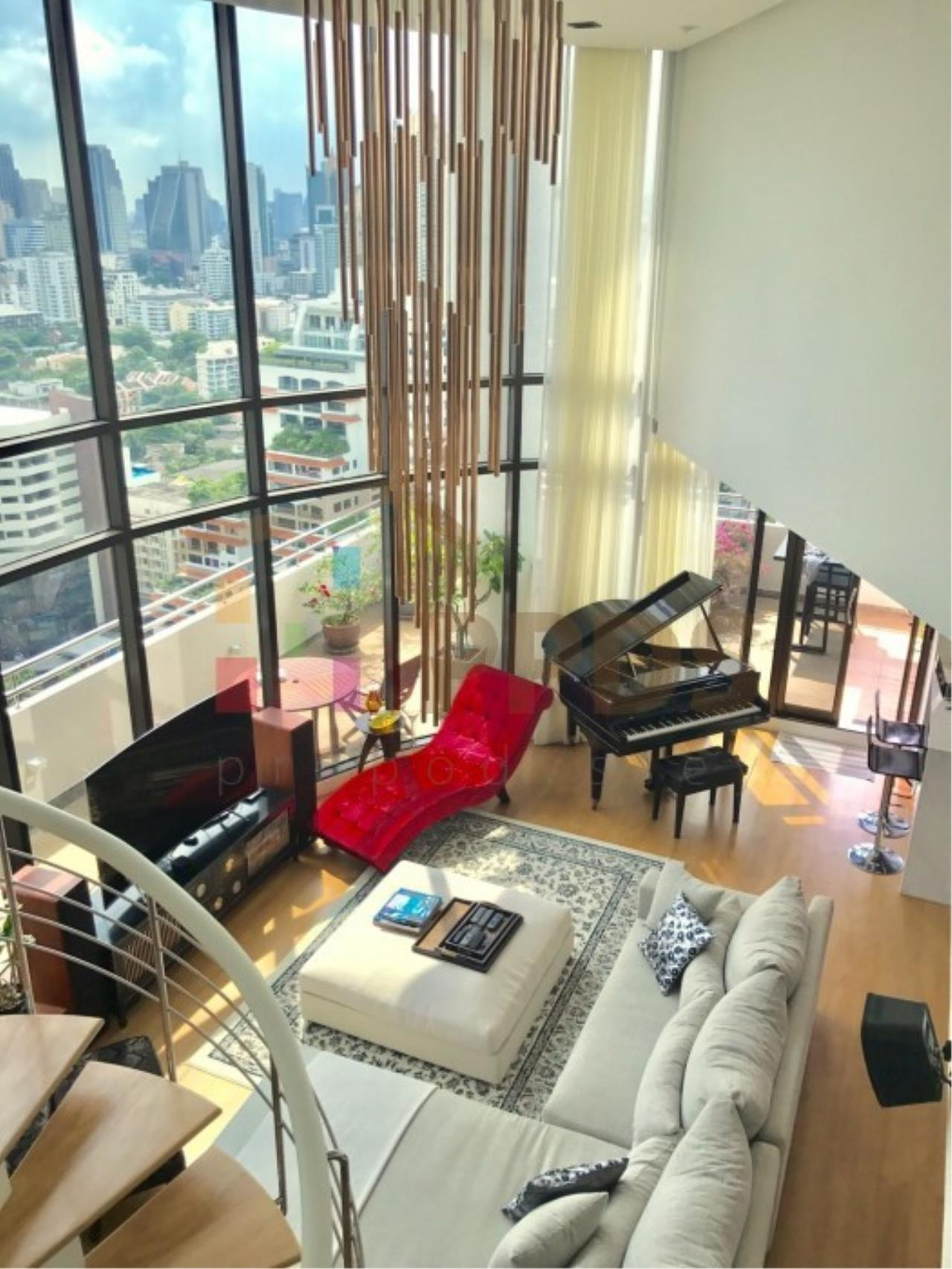 Propodyssey Agency's Duplex Penthouse with a large balcony and city is available for rent on Promphong Area. 25