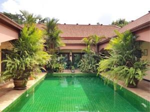 RE/MAX Town & Country Property Agency's Lakeside pool villa for sale 1