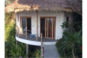 RE/MAX Island Real Estate Agency's sea views Bali style and atypical house. 26