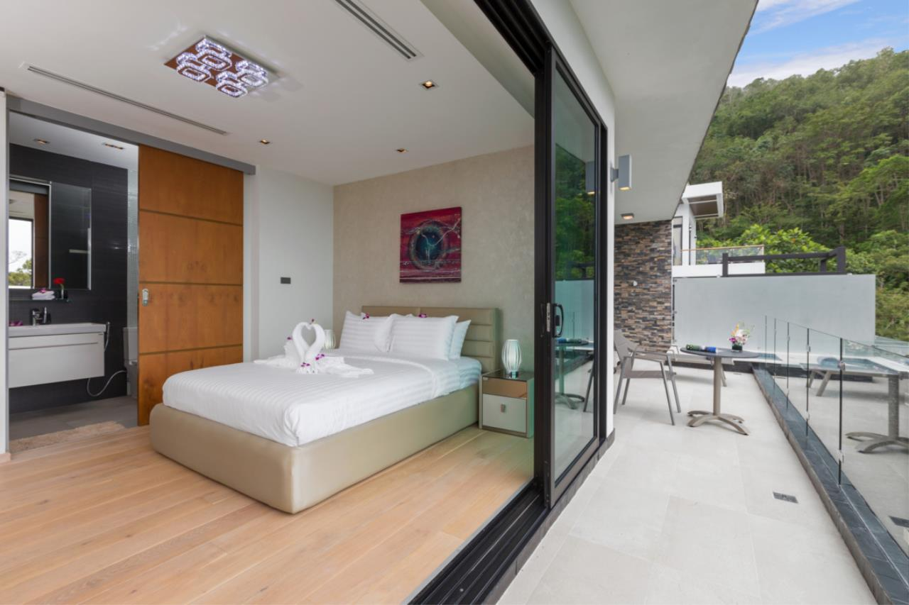 REAL Phuket  Agency's Exquisite 3-Bedroom Sea View Villa in Bang Tao 32