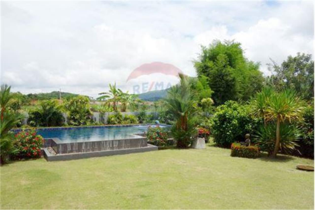 "RE/MAX Executive Homes Agency's ""Chai Dee"" 12.79 M in Baan Melanie plot K-2 21"