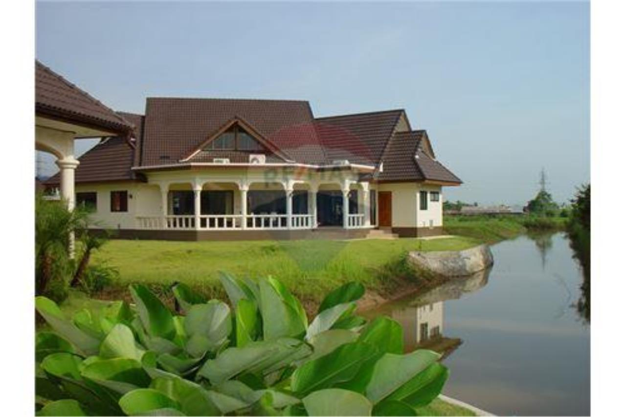 "RE/MAX Executive Homes Agency's ""Chai Dee"" 12.79 M in Baan Melanie plot K-2 1"