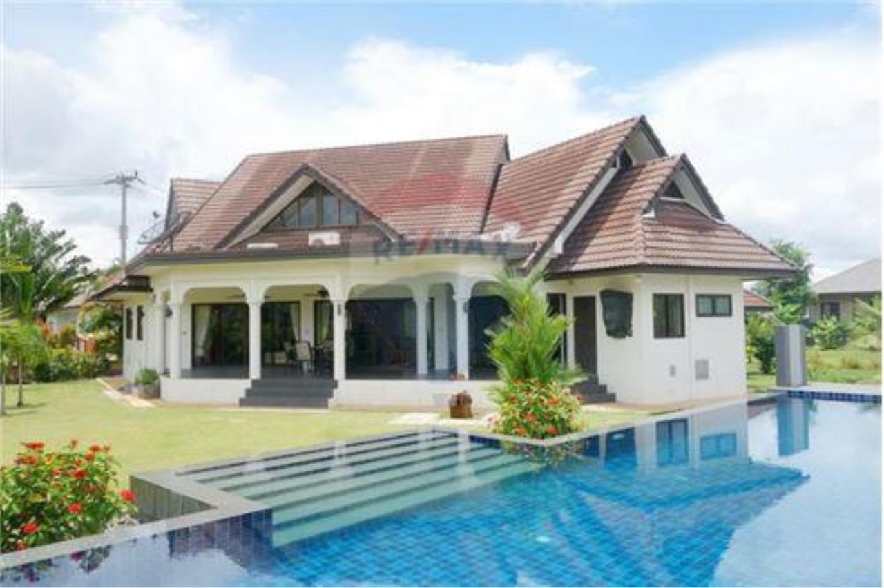 "RE/MAX Executive Homes Agency's ""Chai Dee"" 12.79 M in Baan Melanie plot K-2 2"