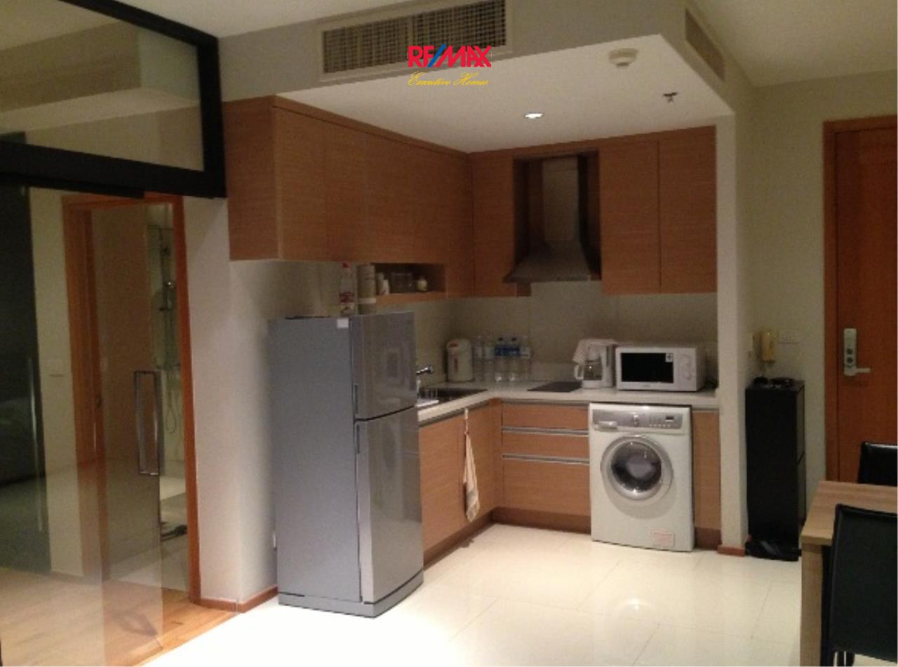 RE/MAX Executive Homes Agency's Cozy 1 Bedroom for Sale Emporio Place 3